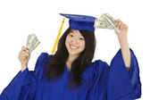 An Asian teenage in blue graduation gown and smiling while hold US money to illustrate to high cost of education. She is on a white background. — Stock Photo