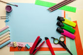 Blue empty sheet with stationery objects. — Stock Photo