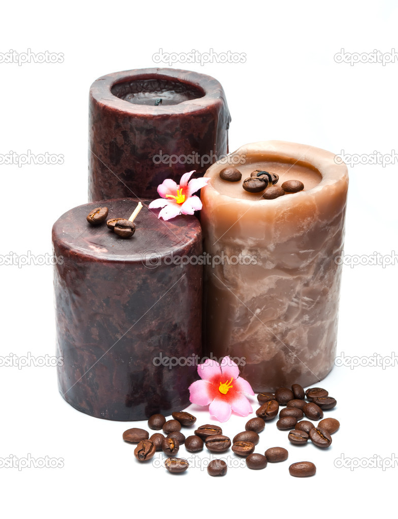 Three thick candles with flowers and coffee beans isolated on white.  Stock Photo #10707850