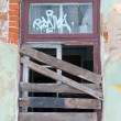 Boarded-up window - Stock Photo