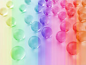 Sprinkled glass balls with a colored background — Stock Photo