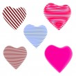 Lot of red, blue striped hearts isolated on white background — Stock Photo #9793951