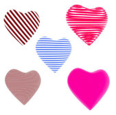 Lot of red, blue striped hearts isolated on white background — Stock Photo