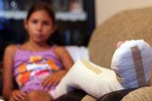 Girl With A Broken Leg — Stock Photo