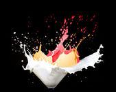 Milk and paint splash — Stock Photo