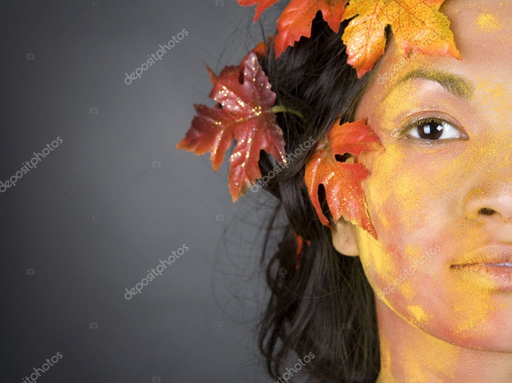 Pretty brunette woman wearing leaves and colorful makeup — Stock Photo #9757928