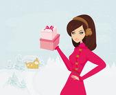 Chica de compras de moda con caja de regalo — Vector de stock