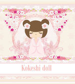 Kokeshi doll on the pink background with floral ornament — Stock Vector