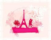 Romantic couple in Paris kissing near the Eiffel Tower. Retro card. — Stock Photo