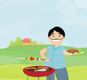 Man cooking on his barbecue — Stock Photo