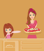 Housewife serving pizza — Stock Photo