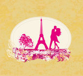 Romantic couple in Paris kissing near the Eiffel Tower. Retro card. — Stock Photo