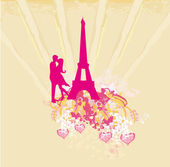 Romantic couple in Paris kissing near the Eiffel Tower. Retro card — Stock Photo