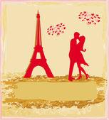 Romantic couple in Paris kissing near the Eiffel Tower Retro card — Stock Photo