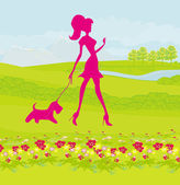 Pretty girl walking the dog — Stock Photo