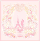 Romantic couple in Paris kissing near the Eiffel Tower Retro card — Stock Photo