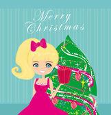 Leuk meisje met de doos van de gift in de buurt van door kerstboom — Stockfoto