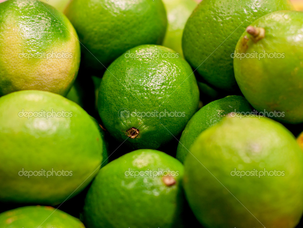 Fresh green limes closeup on a market — Stock Photo #10341460