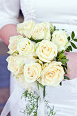 Beautiful bridal bouquet of white roses — Stock Photo