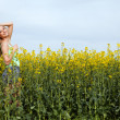 Beautiful blonde girl in a field in summer — Stock Photo