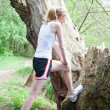 Stock Photo: Young woman is jogging in forest