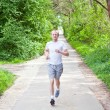 Man is jogging in the forest — Stock Photo