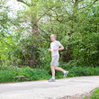 Man is jogging in the forest — Stock Photo #10504979