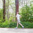 Man is jogging in the forest — Stock Photo #10504997