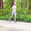 Man is jogging in the forest — Stock Photo #10505010