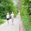 Young couple is jogging in the forest — Stock Photo #10505069