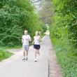 Young couple is jogging in the forest — Stock Photo