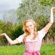 Stock Photo: Young woman with pink dirndl outdoor