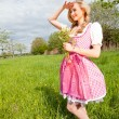 Young woman with pink dirndl outdoor — Stock Photo
