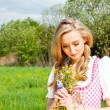 Stock Photo: Young womwith pink dirndl outdoor