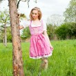 Young woman with pink dirndl outdoor — Stock Photo #10505340