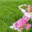 Royalty-Free Stock Photo: Young woman with pink dirndl outdoor