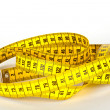 Yellow measure tape with scale in centimeters - Stock Photo