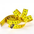 Yellow measure tape with scale in centimeters — Stock Photo #9468475