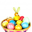 Three different coloured eastrn eggs in a yellow cup - Lizenzfreies Foto