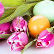 Tulip wit eastern eggs a rabbit and letters in different colours - Stock Photo