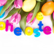 Tulip wit eastern eggs a rabbit and letters in different colours — Stock Photo
