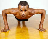 Young man with black skin ist doing fittness — Stock Photo