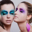 图库照片: Young beautiful woman with an extreme colorfull make up portrait