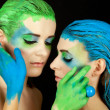 Young beautiful woman with an extreme colorfull make up portrait — Stock Photo