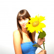 Young beautiful brunette woman with a flower happy — Stock Photo