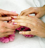 Feminin hands with a treatment doing a manicure closeup — Stock Photo