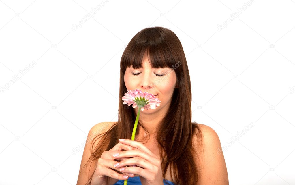 Young beautiful brunette woman with a flower happy  Stock Photo #9914809