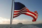Stars and stripes flying over Alcatraz — Stock Photo
