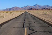 Lonely road through Death Valley National Park — Stock Photo