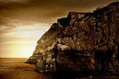 Sepia Tinted Cliff Ruins — Stock Photo